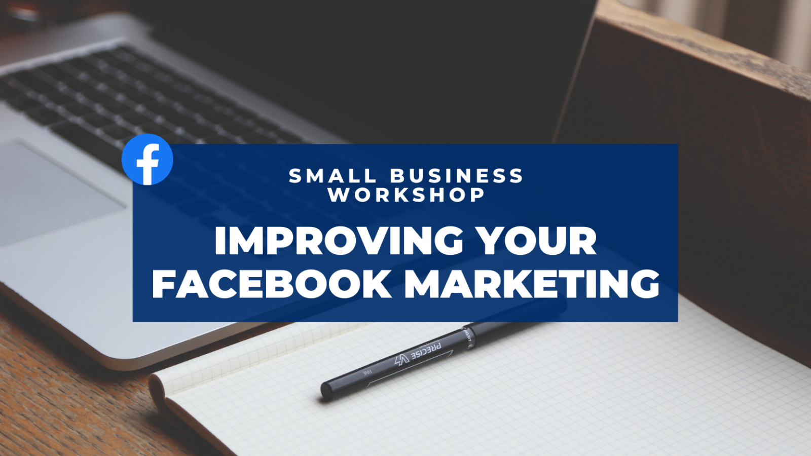Improving your Facebook Marketing at this Small Business Workshop. Laptop and tablet of paper in background.